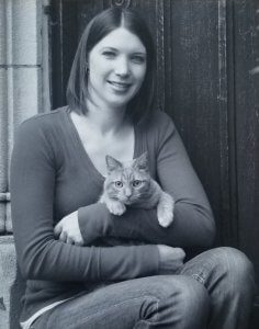 Black and white photo of a woman holding a cat.