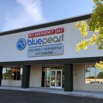 Hospital entrance has a sign that says BluePearl specialty and emergency pet hospital.