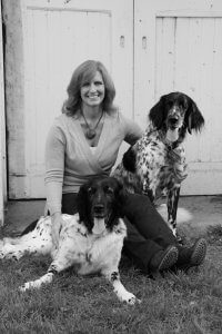 Image of Karen Seger, BluePearl Veterinary Relations Representative for PVSEC in North Hills, PA, smiling with her two dogs.