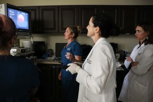 Internal Medicine and Oncology specialists take lung biopsy from large dog.