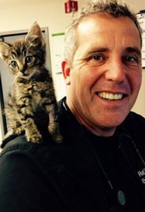 Dr. Rob West is a doctor in our emergency medicine service. He has a kitten on his shoulder.