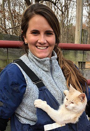 Dr. Zoe Bailey is a small animal medicine and surgery intern. She is with her cat in a front-carry backpack.