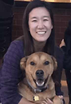 Dr. Esther Choi is a small animal medicine and surgery intern. She is hugging her Labrador retriever mix.