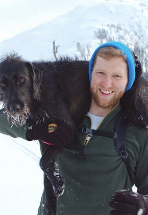 Dr. Hagan Dooley is an intern in our surgery service. He is in the snow with his dog around his shoulders.