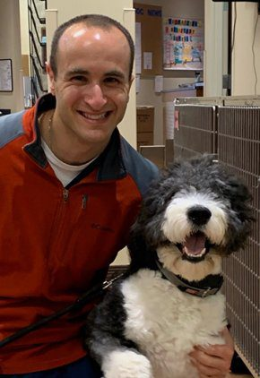 Dr. Ross Feldgreber is a doctor in our cardiology service. He is next to gray and white dog..