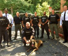 K9 Officer Indi and police pose in front of BluePearl in Sandy Springs