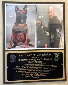 Honorary plaque of K9 Officer Indi and his handler for exceptional services provided by BluePearl Associates in Georgia.