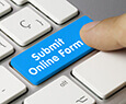 Keyboard with blue key to submit online form