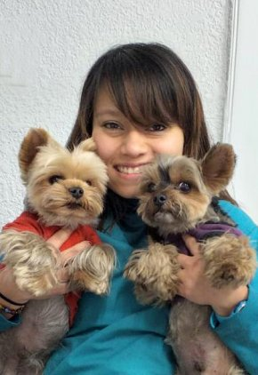Dr. Maria Lozano Araujo is a small animal medicine and surgery intern. She is holding two terriers.