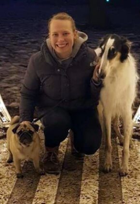 Dr. Leila Kleemola is an emergency medicine veterinarian. She is with two dogs.