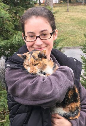 Dr. Sarah Stephan is a veterinarian in our neurology service. She is holding a black, orange and white cat.