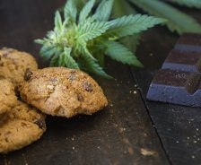 Cookies, marijuana buds and chocolate are on a table.