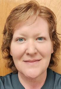 Headshot of a woman wearing a grey shirt