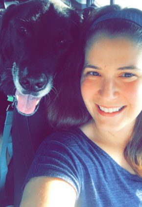 Christine Jones is a licensed veterinary technician with additional board certification in veterinary ophthalmology. She is pictured with a large black dog looking over her shoulder.