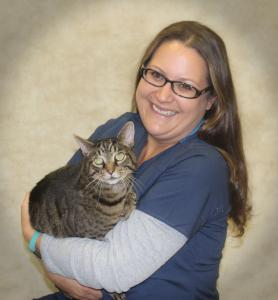 Dr. Laura Roy-Eitner is a doctor in our emergency medicine service. She is holding a cat in her arms.