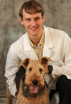 Dr. Bradley Harris is a resident in our critical care service. He is sitting with a large dog.