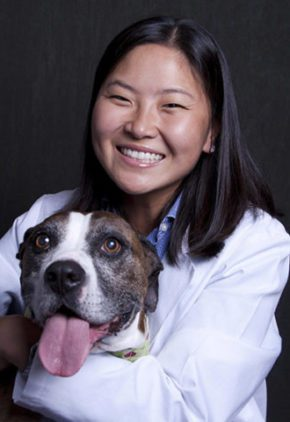 Dr. Sylvia Lee is a doctor in our surgery service. She is holding a large dog in her arms.