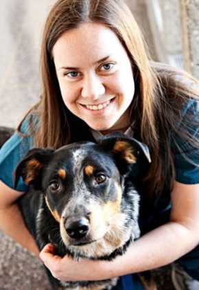 Dr. Julia Disney is board certified in veterinary ophthalmology. She is hugging a dog.