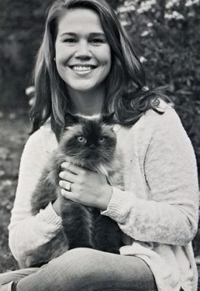 Dr. Kristen Krisulevicz is an emergency medicine veterinarian. She is holding a long-haired cat.