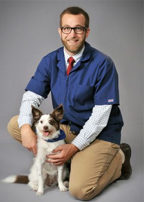 Dr. Tony Jarchow is board certified in veterinary internal medicine. He is holding a small dog.